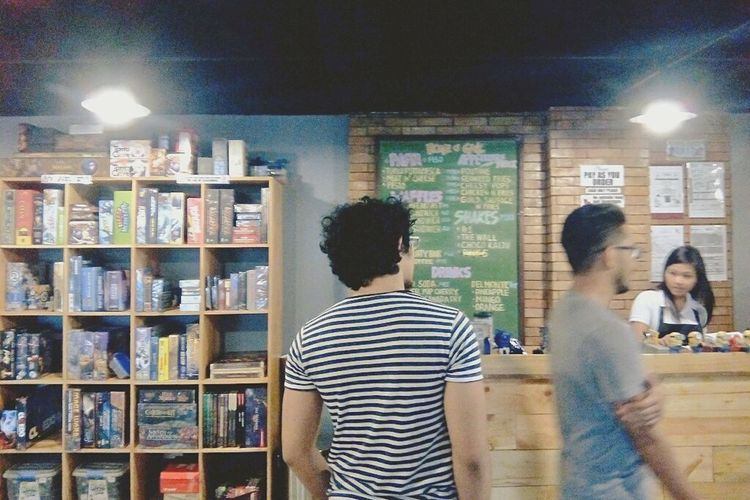 Everything In Its Place board games all in one cabinet at a café in the Philippines. Restaurant Coffee Coffee Shop Board Game Photo Of The Day Cafe Hangouts  Chill Time
