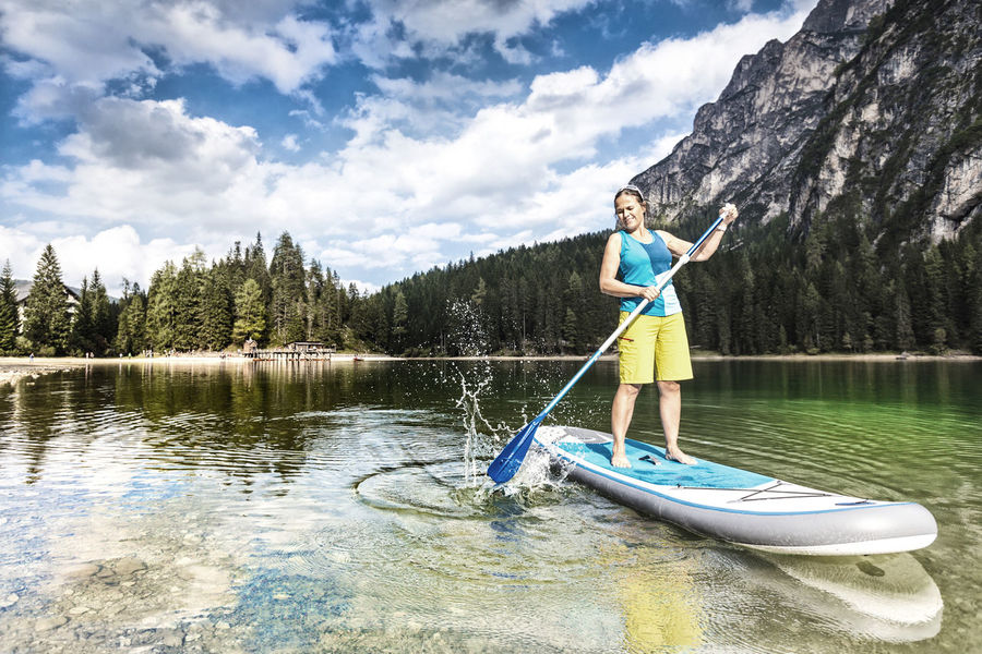 Woman standup paddleboarding at the Pragser Wildsee Activity Adventure Alps Beauty In Nature Braies Dolomites Enjoy Experience Italy Lago Di Braies Lake Nature Outdoors Paddling Pragser Wildsee Pustertal Relax Standup Standup Paddleboarding Standuppaddle Sup Surf Südtirol Val Pusteria Woman