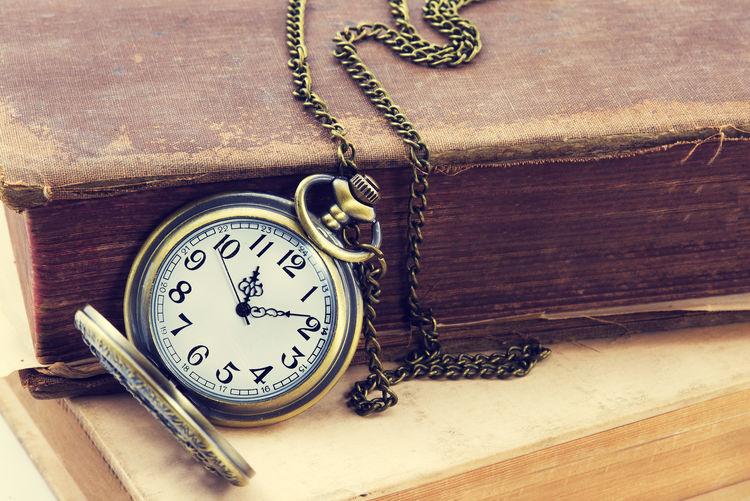 Vintage antique pocket watch, and old book Time Clock Watch Pocket Watch Antique Retro Styled No People Number Close-up Old Instrument Of Time Old-fashioned Vintage Book Remember Memories Nastalgia