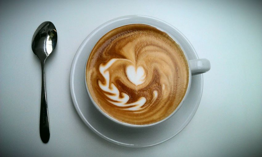 cappucino with decorative foam art in a white mug with a silver spoon Beverage Brown Caffè Cappuccino Close-up Coffee Coffee - Drink Coffee Cup Coffffffee  Cup Design Froth Art Frothy Drink Heart Latte Latte Art Love ♥ No People Overhead View Refreshment Saucer Still Life