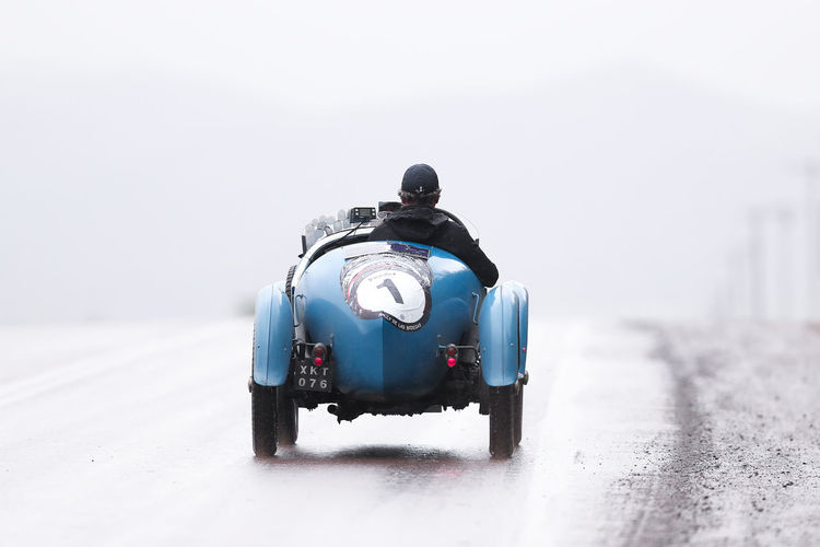 Mode Of Transportation Transportation Land Vehicle Motorcycle Road Motion Day One Person on the move Car Motor Vehicle Travel Cold Temperature Nature Security Winter Helmet Outdoors Crash Helmet Road Trip