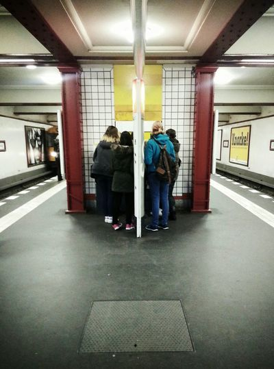 In the middle there's a riddle ... Subway Running Late Commuting Public Transportation Notes From The Underground The Street Photographer - 2016 EyeEm Awards People Watching Moments Of Life Streetphotography Streetphoto_color Streetscene Weilwirdichlieben Bvg Architecture At The Station Buying Tickets My Fuckin Berlin Symmetry Symmetrical Symmetryporn Symmetrykillers My Commute