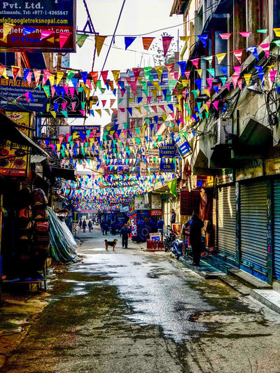 Flags waving on an early morning in a Thamel street in Kathmandu City Flags Incidental People Market Multi Colored Shopping Store Street