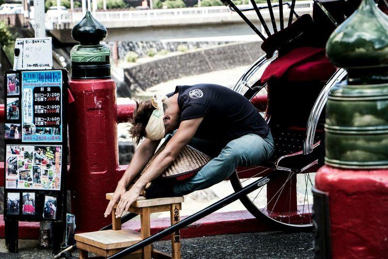 This is taken in Hakone Japan of a rickshaw runner resting before his next customer Hakone Japan Rickshaw