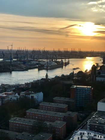 Transportation Commercial Dock Water Sunset High Angle View Nautical Vessel Harbor Building Exterior Travel Destinations Architecture Sky No People Shipping  River Cityscape Cloud - Sky Built Structure City Industry Outdoors Seaside Moments Traveling Hamburg Germany