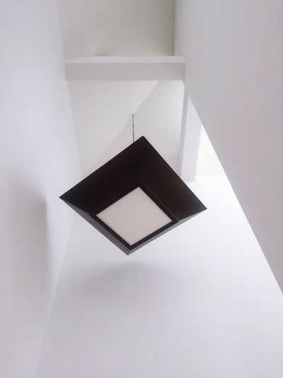 High angle view of paper on white wall