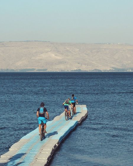 CyclingUnites Mode Of Transport Men Bicycle Real People Transportation Sea Clear Sky Outdoors Sky Nature Finding New Frontiers Sport Nautical Vessel Day Mountain Beauty In Nature Sports Clothing Traveling Home For The Holidays The Great Outdoors - 2017 EyeEm Awards מייאופניים מייכינרת Enjoy The New Normal My Year My View Live For The Story
