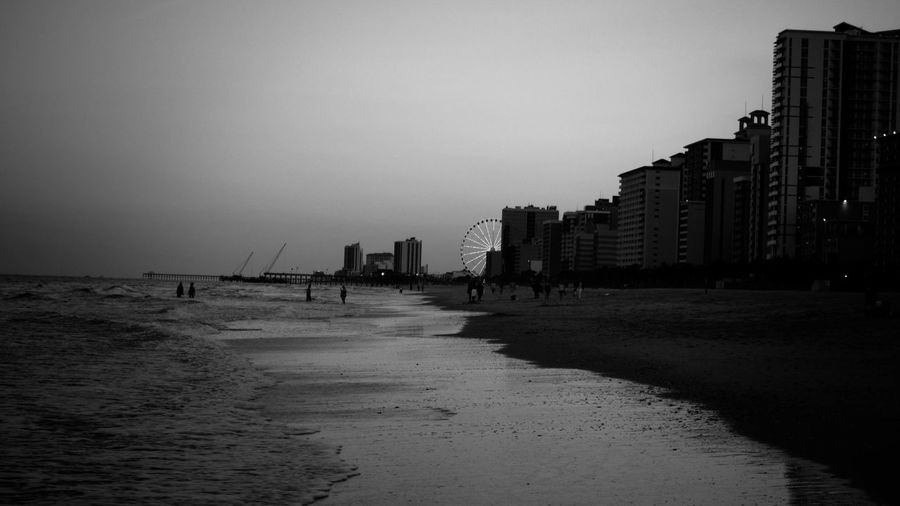 Beach Black Built Structure Clear Sky Ferris Wheel Myrly Outdoors Sand Sea Sky Tourism Vignette Water Waterfront