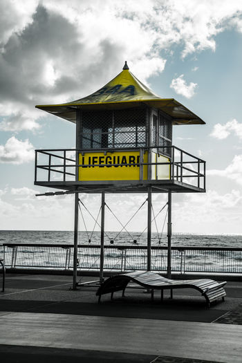 A surf lifesaving tower at the beach front at Surfers Paradise on the Gold Coast of Australia. Beach Clouds And Sky Creative Photography Gold Coast Australia Lifeguard Hut Lifeguard Tower Surf Life Saving Surfers Paradise, Australia