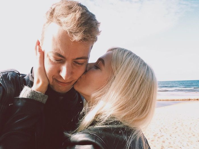 Close-up of young couple kissing on beach