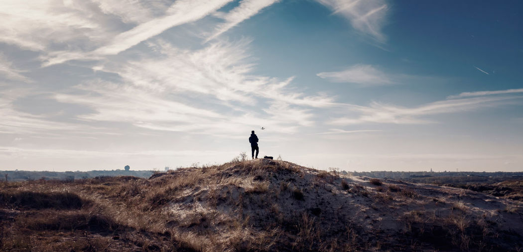 Man on landscape against sky