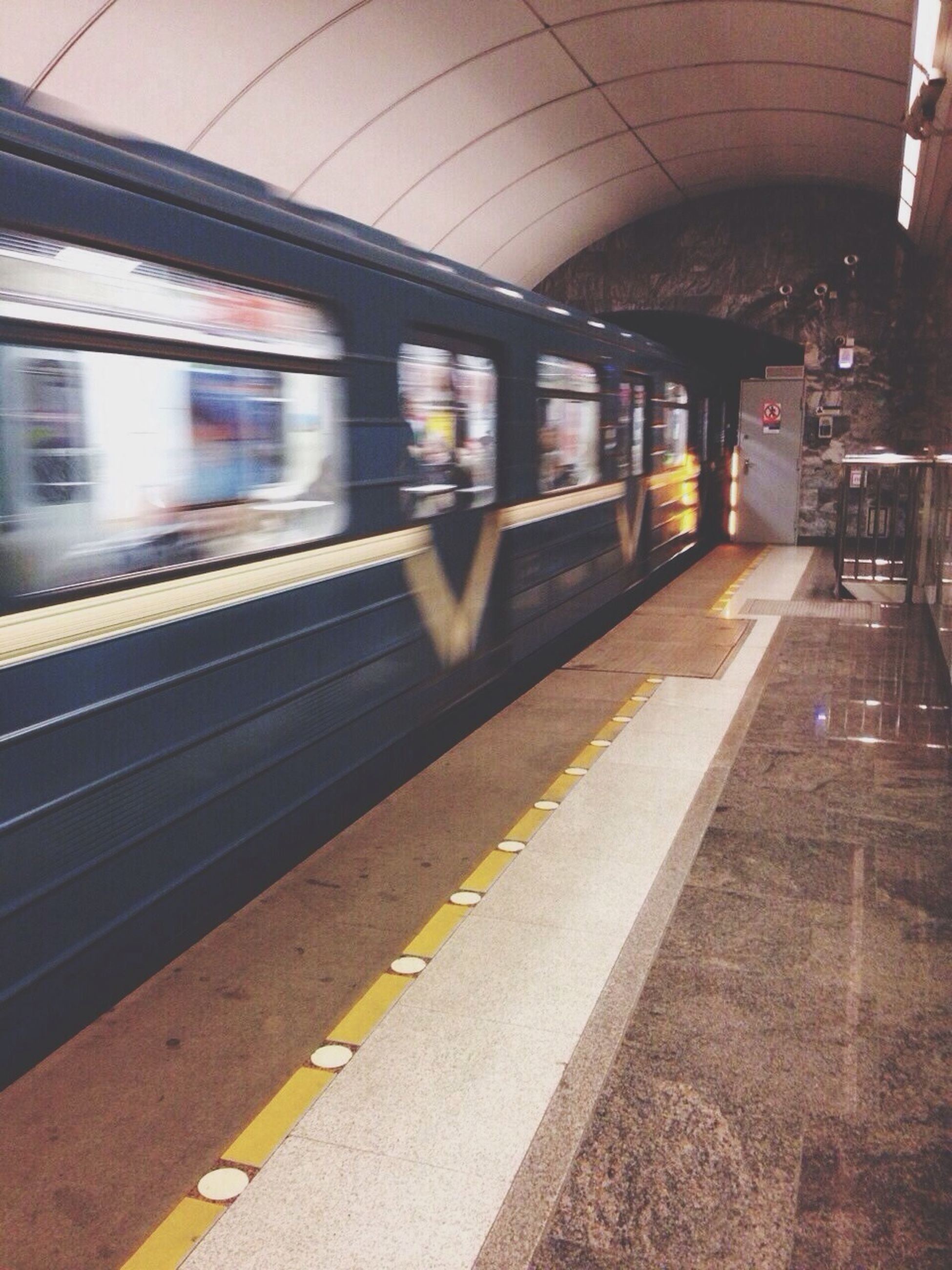 transportation, railroad station platform, public transportation, railroad station, railroad track, rail transportation, train - vehicle, mode of transport, travel, passenger train, train, public transport, subway station, blurred motion, motion, illuminated, built structure, railway station, speed, indoors