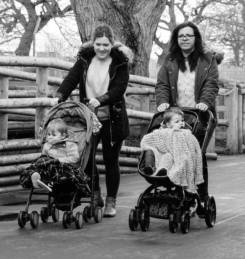 Street Photography Streetlife Lifestyles Monochrome Photography Black And White Dayout Mothers Children Pushchair Buggy Walking People Candid
