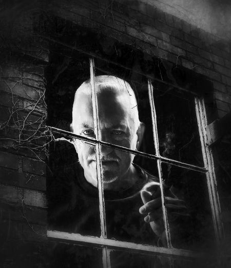 """In the Window"" Cigar Brick Factory Brick Facade Old Building  Window Portrait Constructed Black And White One Person Real People Headshot"