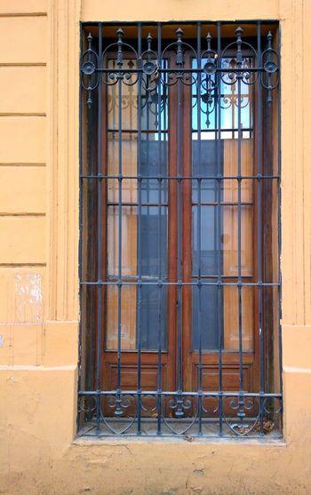 Colonial window in the street