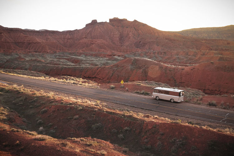 Driving from Moab, Utah, into Castle Valley in our 1964 Campervan. Vanlife Campervan Desert Landscape Desert Canyons Utah Road Trip American West EyeEmNewHere Recreational Vehicle Adventure Red Rock Formation Wilderness Remote Location Travel Destinations Outdoor Travel Off Grid Motor Vehicle Mountain Car Landscape Arid Climate Travel