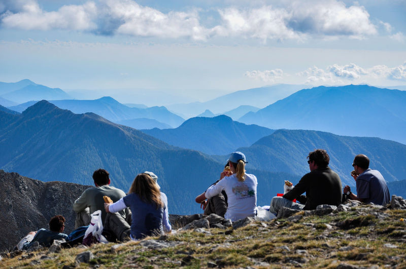 Group of hikers resting in the mountains