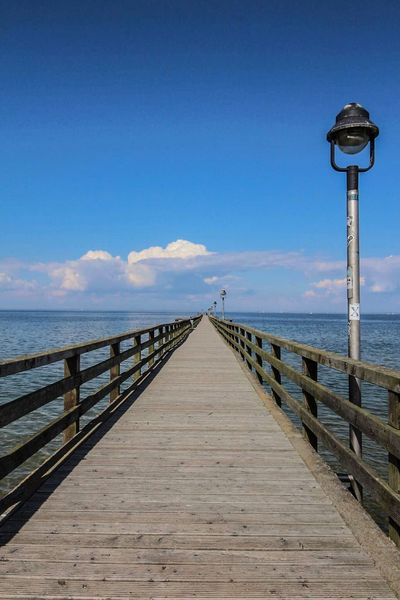 Sea Railing Pier Water Blue Nature Jetty Sky Horizon Over Water No People Outdoors Day Beach Clear Sky Beauty In Nature Wood Paneling Canonphotography Mecklenburg-Vorpommern Lubmin Greifswalder Bodden Seebrücke