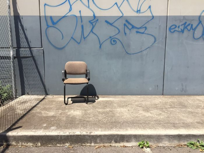 Grey wall with chair. Notes From The Underground DocumentingSpace Melbourne Australia Urbanphotography