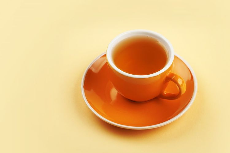 Drink Food And Drink Mug Refreshment Cup Saucer Tea Cup Tea - Hot Drink Hot Drink Tea Heat - Temperature Coffee Cup Freshness Indoors  Afternoon Tea Crockery Studio Shot No People Tea Time Yellow Background