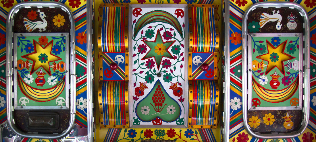 Close-up Colourful Decorative Holi India Interior Style Multi Colored No People Pattern Roof Travel Truck Vibrant Paint The Town Yellow