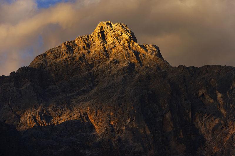 Rocky landscape against clouds