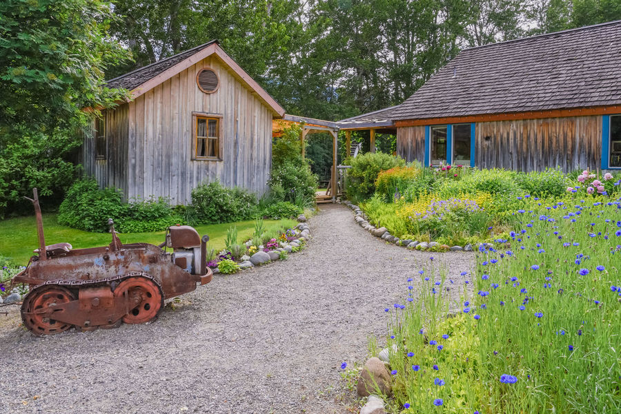 Keremeos, British Columbia/Canada - June 3, 2017: garden pathways at the entrance to The Grist Mill and Gardens Keremeos, an important heritage site dating to 1877. 1800's 1877 Afternoon Beautiful British Columbia, Canada Garden Path Scenic Similkameen Valley The Grist Mill And Gardens Keremeos Travel Aged Editorial  Gardens Heritage Site Historic Site June Keremeos Museum Old Old-fashioned Outdoors Spring Tourism Tours Vintage