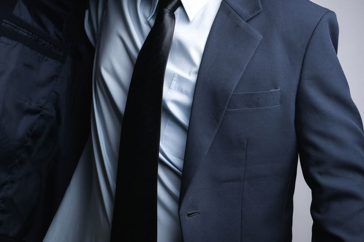 Business man dressing up on white background Midsection Men Business Menswear Necktie One Person Business Person Businessman Front View Well-dressed Clothing Suit Button Down Shirt Standing Real People Indoors  Formalwear Males  Occupation Suit Confident  Professional Formation Neat Uniform First Eyeem Photo