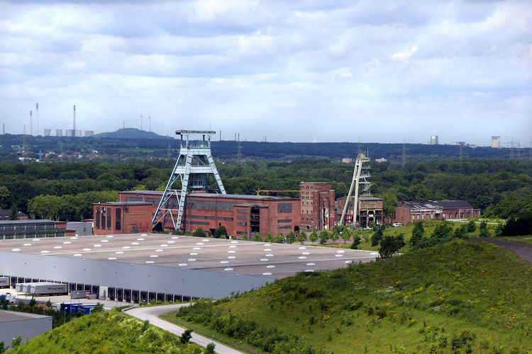 High angle view of historical coalmine buildings against sky