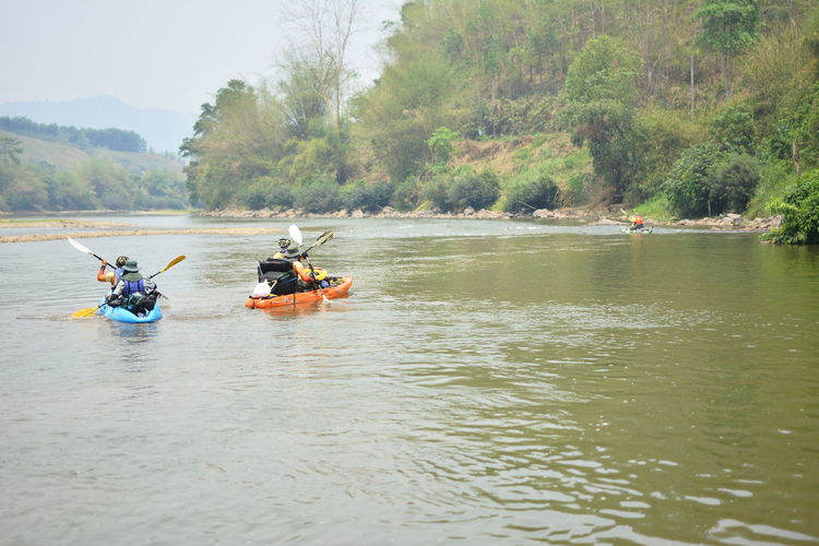 Water Outdoors Chiang Rai, Thailand Transportation Nautical Vessel Waterfront Mode Of Transportation Men River Day Group Of People Nature Adventure Plant Kayak Tree Real People Leisure Activity People Lifestyles Oar Inflatable