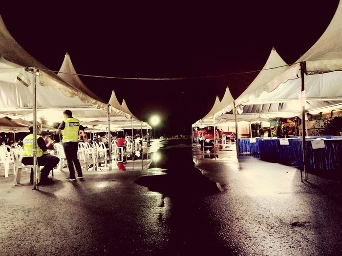 People in market at night