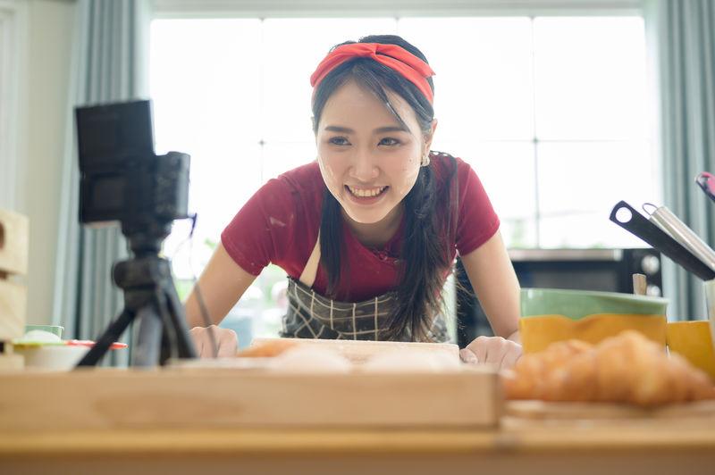 Portrait of woman preparing food