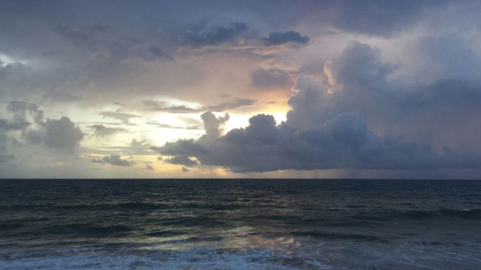 Sunrise Today Light Behind Clouds Water Reflections Orchid Island, Florida