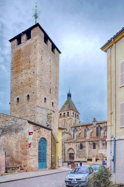 """A view of the Cluny Church and WW II Memorial past the """"Cheeze Tower"""" in Cluny, Burgundy. Cluny  Burgundy France tower Stone Built Ancient Monument"""