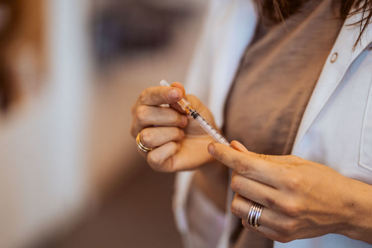 Close-up of woman hand holding cigarette