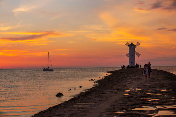Baltic Sea Stawa Mlyny Arms Raised Cloud - Sky Horizon Horizon Over Water Human Arm Leisure Activity Lifestyles Men Nature Nautical Vessel Orange Color Real People Scenics - Nature Sea Sky Sunset Togetherness Transportation Two People Water