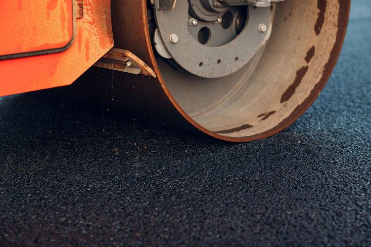 Close-up of road roller on asphalt