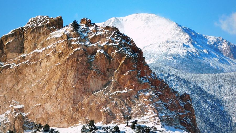 Pikes Peak and Garden of the Gods Beauty In Nature Cold Temperature Day Environment Formation Mountain Mountain Peak Mountain Range Nature No People Outdoors Rock Rock - Object Scenics - Nature Sky Snow Snowcapped Mountain Solid Tranquil Scene Tranquility Winter