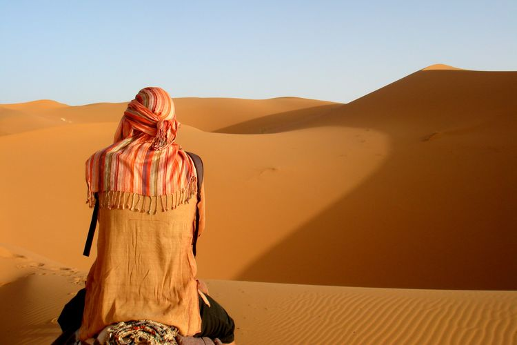 Photo Of Man On The Dessert During Daylight Sand Dune Desert Arid Climate Sand Standing Heat - Temperature Sky Landscape Traditional Clothing Drought
