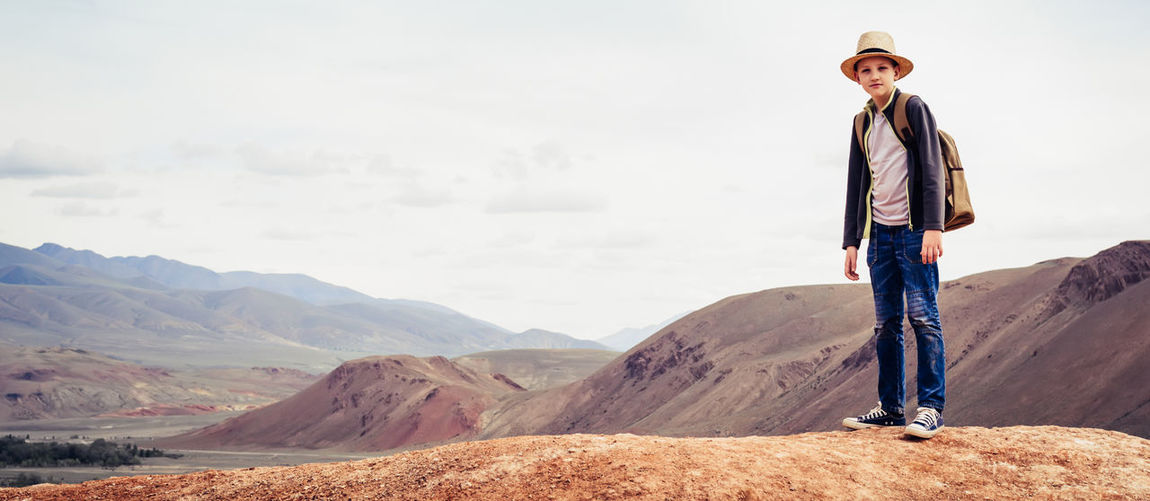 Man standing in mountains against sky