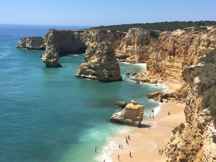 Portugal Praia Da Marinha Algarve Water Sea Land Scenics - Nature Beauty In Nature Rock Nature Beach Sky Tranquil Scene Tranquility Rock - Object Day Clear Sky Outdoors Sunlight