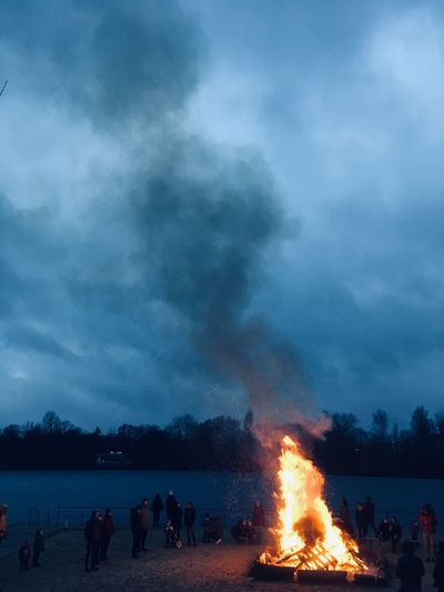 Heat - Temperature Burning Fire Group Of People Fire - Natural Phenomenon Flame Night Water Smoke - Physical Structure Accidents And Disasters Crowd Celebration Bonfire Power In Nature
