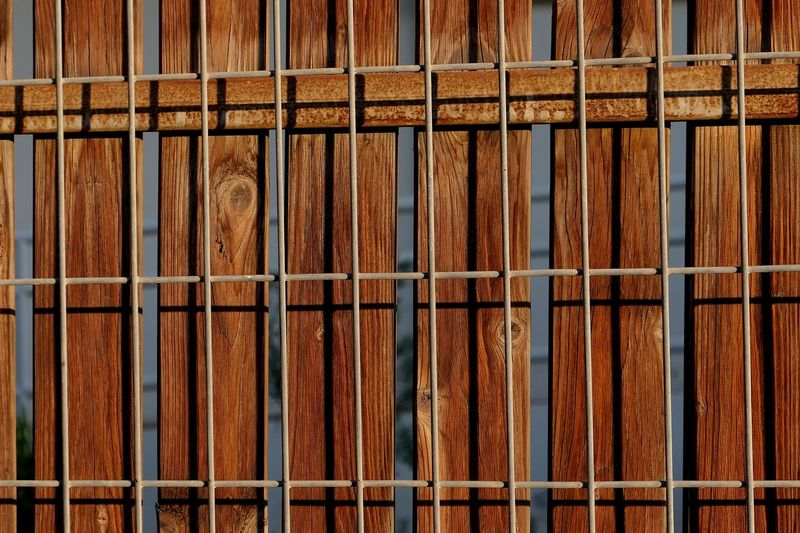 Full Frame Backgrounds No People Metal Pattern Rusty Day Wood - Material Textured  Outdoors Side By Side Close-up Brown Fence Barrier Sunlight Repetition