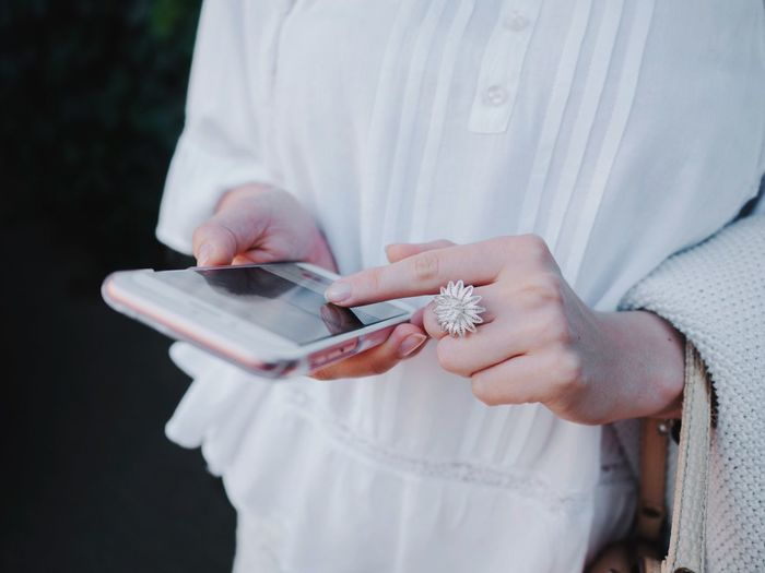 Close-Up Of Woman Holding Mobile Phone