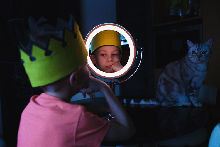 Close-up of boy looking in mirror
