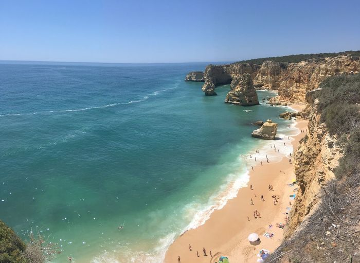 Praia Da Marinha Praiadamarinha Sea Water Land Beauty In Nature Beach Scenics - Nature Sky Non-urban Scene High Angle View Clear Sky Day Tranquil Scene Nature Horizon Over Water Tranquility Idyllic Blue Sand Horizon
