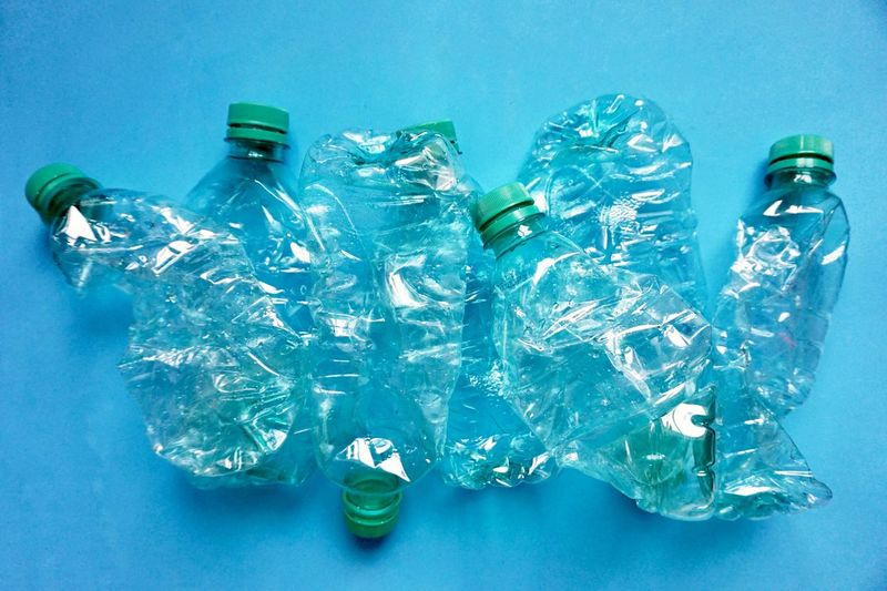 High angle view of bottles on blue table