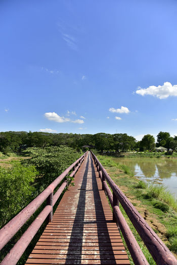 View of bridge on landscape against sky