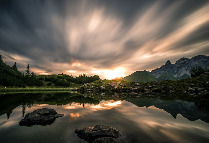 Dramatic Sky Hiking Sunlight Adventure Beauty In Nature Cloud - Sky Day Idyllic Lake Landscape Light And Shadow Longexposure Mountain Nature No People Outdoors Reflection Scenics Sky Sun Sunset Tranquil Scene Tranquility Water Waterfront
