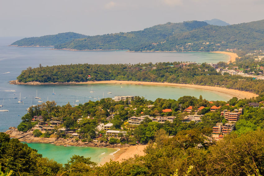 Beautiful seascape of turquoise ocean waves with boats, coastline and blue sky background from high aerial view point of Kata and Karon beaches in Phuket Thailand. Aerial View Of Beach Coastline Coastline Landscape Karon Beach, Phuket Karon Beach, Phuket, Thailand Kata Beach Kata Beach,Phuket Thailand Kata Beach Phuket, Thai Seascape Photography Aerial View Aerial View Of City Architecture Beauty In Nature Building Exterior Built Structure Coastal Coastal Landscape Coastline Beauty Coastline Sky Day High Angle View Karon Beach Karon View Point Karon Viewpoint Kata Kata Noi Beach Landscape Mountain Mountain Range Nature No People Outdoors River Scenics Seascape Seascape Skyscape Sky Tranquil Scene Tranquility Tree Turquoise Turquoise Sea Water
